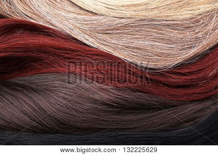 Varicolored strands of hair, close up
