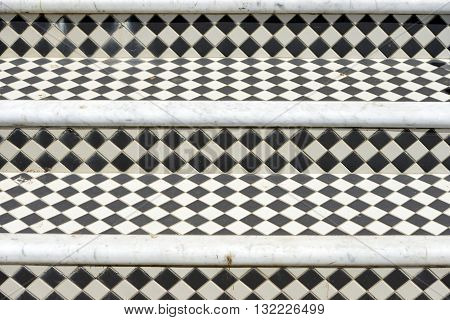 Black and white diamond tiles on Georgian steps