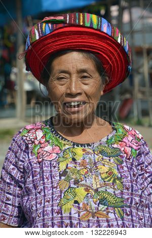 SANTIAGO DE ATITLAN GUATEMALA APRIL 29 2016: Tzutujil woman show to wearing a traditional toyocal hat. The Mayan people still make up a majority of the population in Guatemala,