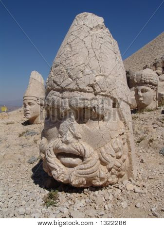 Ruined Statues Of Ancient Gods