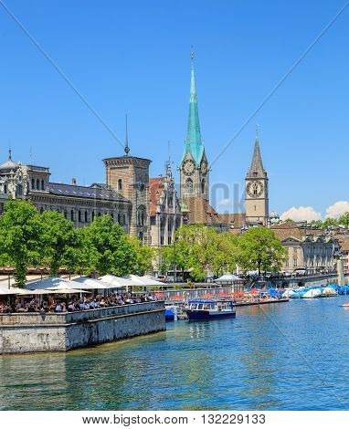 Zurich, Switzerland - 26 May, 2016: famous buildings on the Stadthausquai quay - Zurich City Hall (German: Stadthaus), Fraumunster cathedral, St.Peter Church. Zurich is the largest city in Switzerland and the capital of the Swiss canton of Zurich.