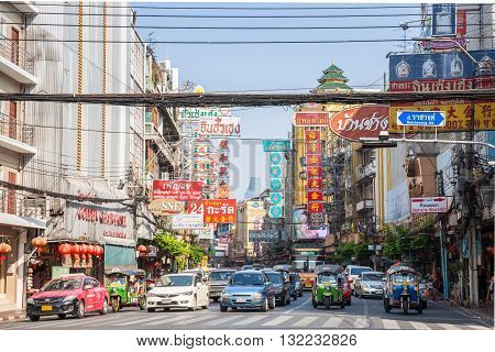BANGKOK THAILAND - APRIL 24: Cars stand before the traffic light on April 24 2016 in Bangkok Thailand.