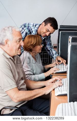 Tutor Helping Senior Woman In Using Computer