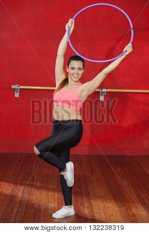 Woman Dancing While Holding Hoop In Zumba Class