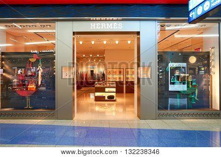 DUBAI, UAE - APRIL 08, 2016: Hermes store at Dubai International Airport. Dubai International Airport is the primary airport serving Dubai, United Arab Emirates