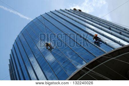 Asian Worker Climb On Building, Dangerous Job