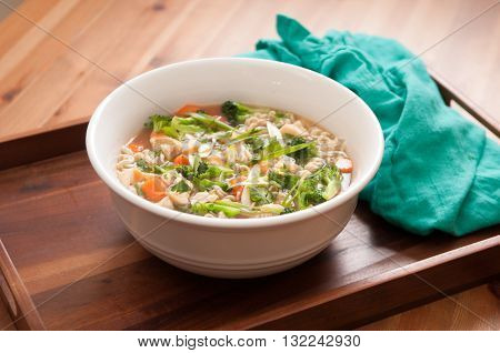pho soup with fresh chicken and vegetables ramen noodles and onion