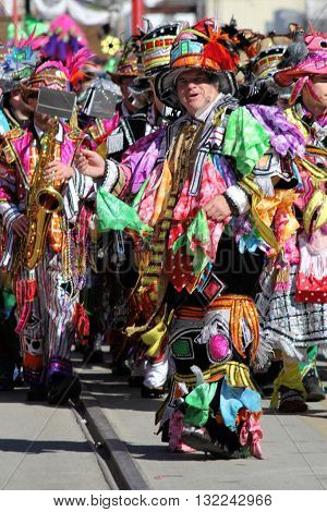 GALVESTON, TEXAS/USA - February 7 2016: 12th Annual Firefighter's Children's Parade in Galveston, Texas features the Quaker City String Band Philadelphia Mummers.  The colorfully costumed band members opened this family friendly event.