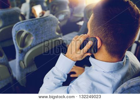 transport, tourism, business trip and people concept - close up of man with smartphone and laptop calling in travel bus