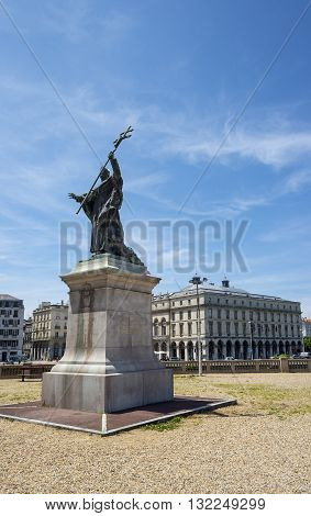 Bayonne France - May 21 2016: Statue of Cardinal Charles Martial Lavigerie in Place du Reduit with Hotel de ville (City Hall) of Bayonne called Mairie de Bayonne in background. Aquitaine France