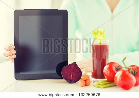 healthy eating, technology, diet and people concept - close up of woman hands with tablet pc, tomato juice and vegetables