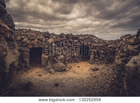 Old homes entrance in an archaeological site of an old aboriginal village in Fuerteventura, Canary Islands, Spain