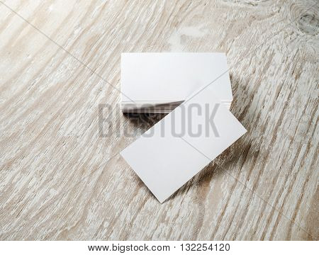 Blank business cards. Photo of blank business cards on on light wooden table background. Template for ID. For design portfolios.