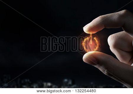 Power symbol between fingers