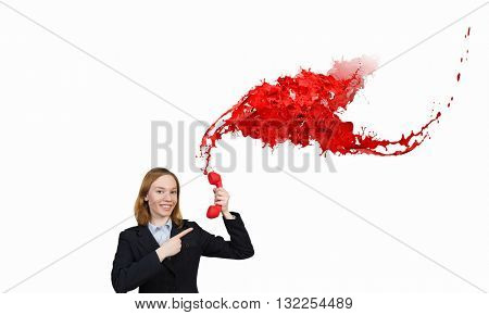 Woman holding red phone handset