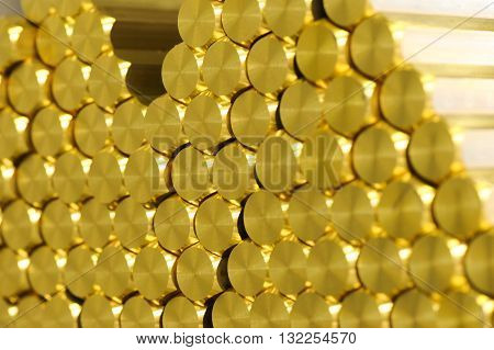 Close Up On Brass Rods In Stack