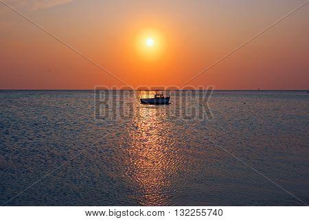 Little old fishing boat at Aruba island in the Caribbean sea  at twilight