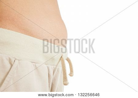 Close-up skinny guy's belly, with white copy space