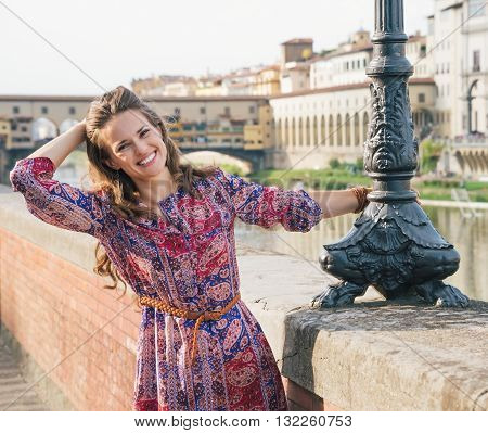 Portrait Of Happy Woman On The Embankment Near Ponte Vecchio