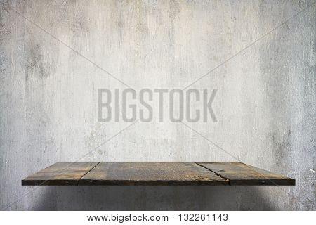 empty shelves on concrete wall