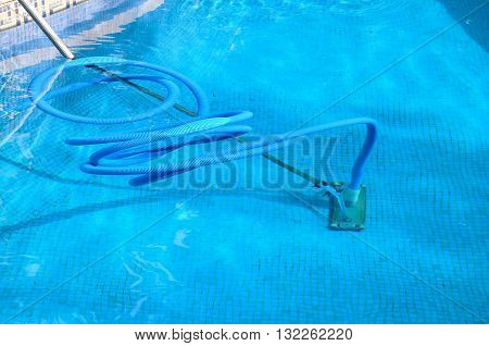 Cleaning equipment in a swimming pool Costa del Sol Andalucia Spain Western Europe.