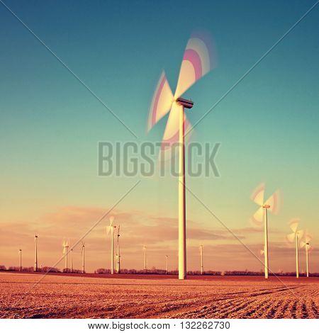Wind Turbine On Sunset