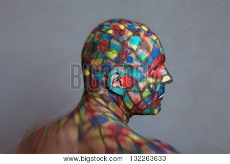 Superhero profile portrait colorful body art with tilt shift and motion blur effect.