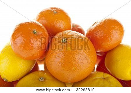 Fresh citrus fruits, mandarines, clementines, tangerines on a market