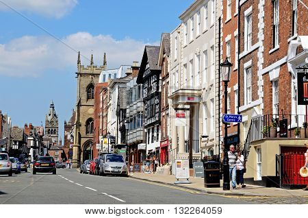 CHESTER, UK - JULY 22, 2014 - Buildings and shops along Bridge Street with St Peters church and St Michaels church to the rear Chester Cheshire England UK Western Europe, July 22, 2014.