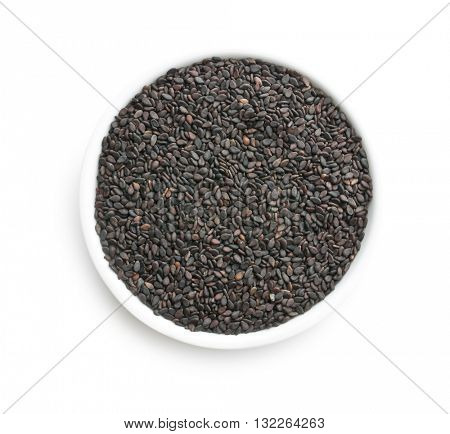Black sesame seeds. Healthy sesame seeds in bowl  isolated on white background. Top view.