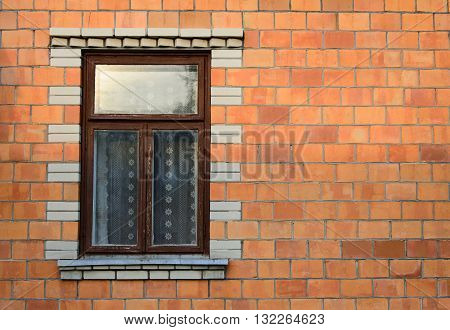 Old window in an old brick wall