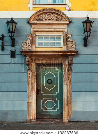 Vintage Door On A Old Building Facade With Retro Lamp In Old Riga City, Latvia