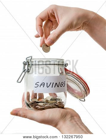 Hands Hold Savings In Jar. Isolated On White Background.