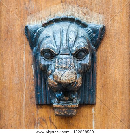 Door decoration or handle - lioness or panther head.