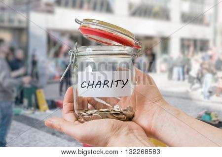 Hands Of Volunteer Holds Jar With Coins. Collecting Money For Ch