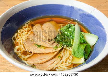 close up of stewed duck with egg noodles soup