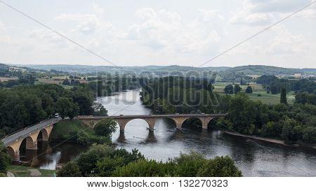 Bridges span France's Dordogne River in the Perigord