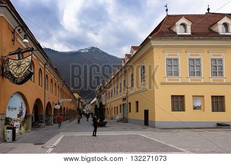 BRASOV ROMANIA - MARCH 09 2016: Photo of downtown and streets with the famous Brasov inscription on the mountain.