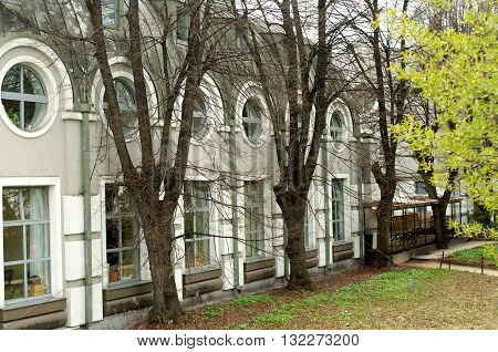 Building with round windows in Moscow with trees