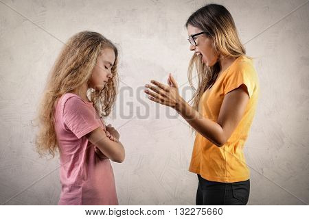 Angry girl blaming her sister