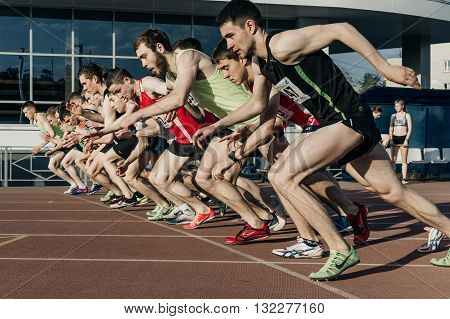 Chelyabinsk Russia - May 24 2016: group start men athletes at stayers distance of 1500 meters in stadium during UrFO Championship in athletics