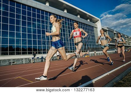 Chelyabinsk Russia - May 24 2016: group of girls leaders stayers running a distance of 1500 meters during UrFO Championship in athletics