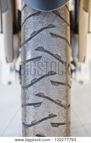 Close up shot of a motorcycle wheel.