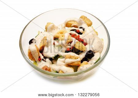 A Bowl of Fresh Salad with Creamy Dressing