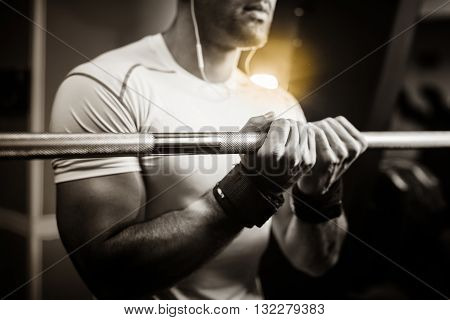bodybuilder guy hands close up monochrome in fitness gym