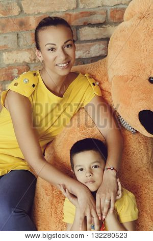 Woman and son with teddy bear