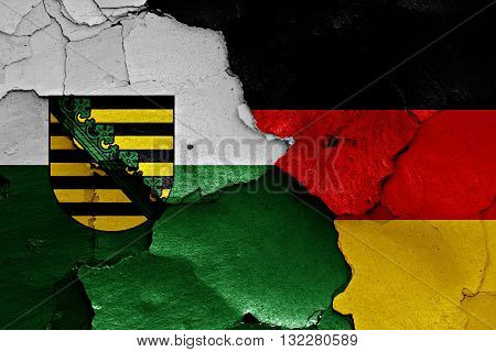 Flags Of Saxony And Germany Painted On Cracked Wall