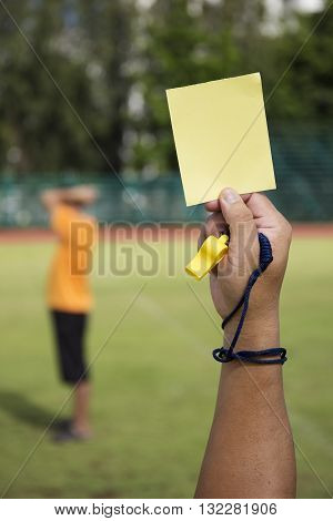 soccer Referee show yellow card recorded player foul in the game