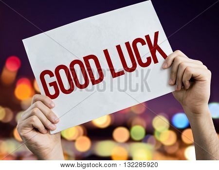 Good Luck placard with night lights on background
