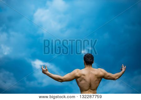 Sexy Muscular Man On Blue Sky